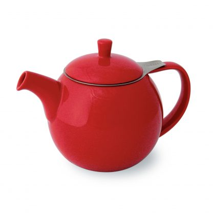 Bright red round teapot with curved spout and handle, lid with post handle, and stainless steel infuser basket with handle extending outside the lid on white background
