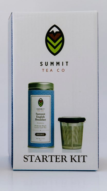 Tall white gift box with Summit Tea's logo at the top and photos of Summit English Breakfast tea in a tin with a stainless steel infuser with insulating wings and lid/saucer on white background