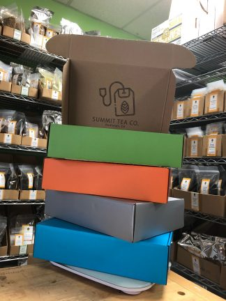 Four seasons gift boxes: blue = spring; silver = winter; orange = fall; green = summer with hinged lids and Summit Tea's rubber stamp on the inside cover