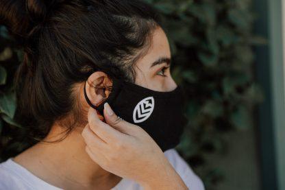 Woman adjusting Summit Tea Black Cloth Face Mask