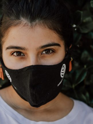 Woman wearing Black Summit Tea Cloth Facemask