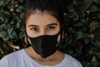 Woman wearing Black Summit Tea Cloth Facemask
