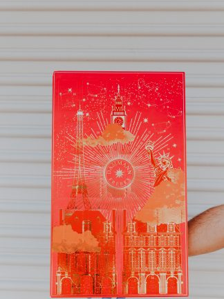 Advent Calendar colored red with gold foil images depicting monuments